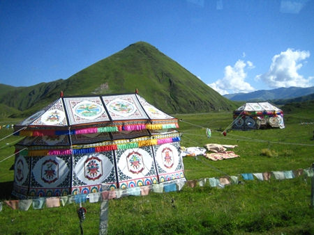 Tibetan tents decorated with appliqué near Litang, eastern Tibet. From richandyon.com, 2006