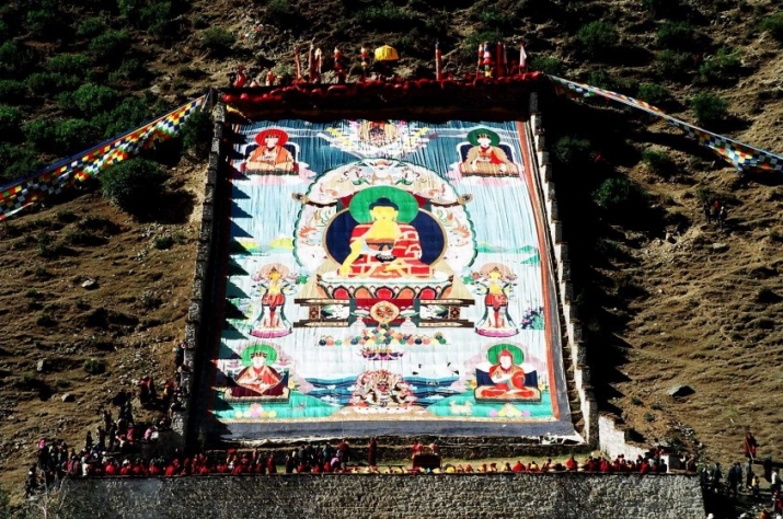 Karma Gadri thangka at Tsurphu Monastery, created by thangka artists Terris and Leslie Nguyen Temple in collaboration with the White Conch factory in Lhasa from 1992–94 and displayed at the annual event of Saga Dawa. From leslienguyentemple.com