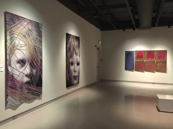 "Two of my favorite pieces at Fiber Art Master Works: Lia Cook's ""Traces Past"" (shown next to her ""Doll Face"") and Michael Rohde's ""From My House to Your Homeland."" Exhibition runs May 20 thru Aug 28, 2016 at the Fresno Art Museum."