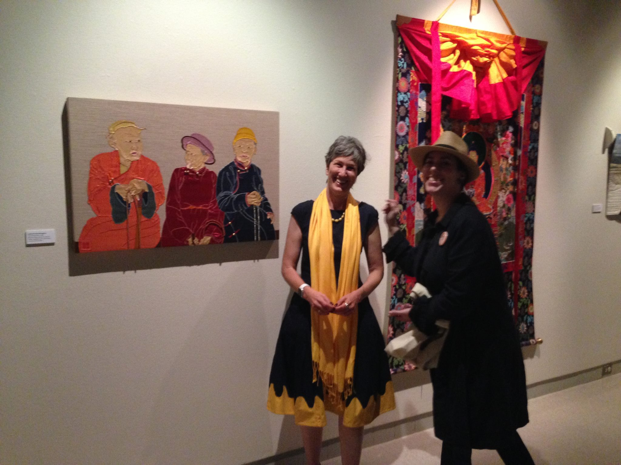 "CaptionLeslie Rinchen-Wongmo with her ""Three Mongolians"" at the Fiber Art Master Works opening, May 20 2016 at the Fresno Art Museum."